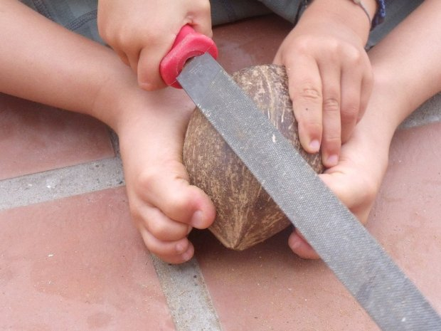One of my kids filing a coconut
