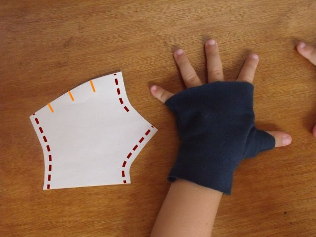 Fingerless mittens and pattern piece with sewing lines and optional finger separations
